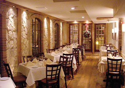 Upstairs dining room with stone wall